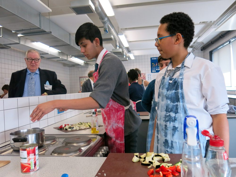 Pupils of Bow School cooking lunch for The Geezers