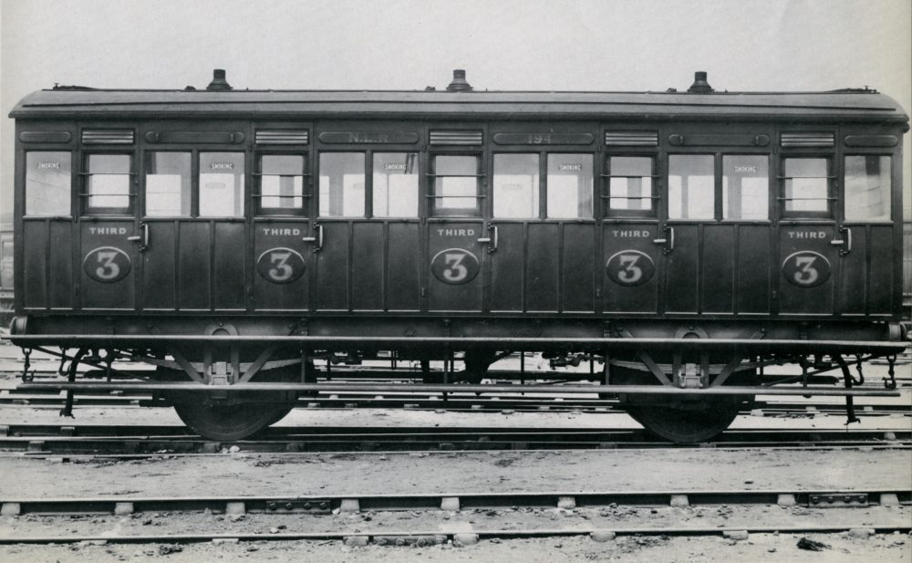A third class coach built in 1903 at Bow. 2d flat rate return workman's tickets were valid in this. The three little chimneys are for gas lights which were installed throughout these trains. Image courtesy Science Museum Group.