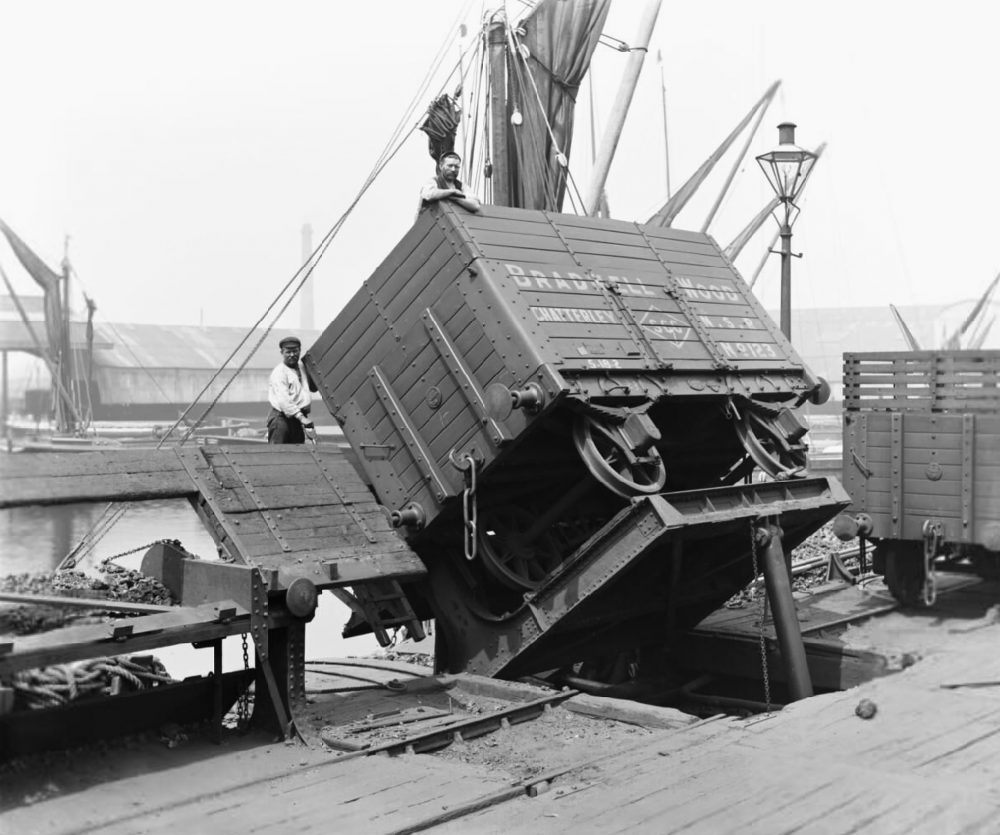 A coke wagon on a hydraulic tip in Poplar Docks, 1898. Image courtesy Science Museum Group.