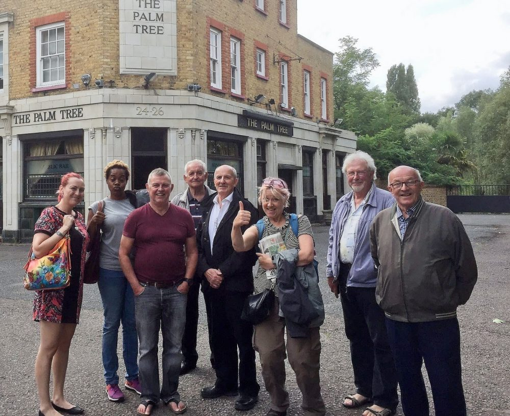 Don with fellow Geezers Ricky Ayliffe and Ray Gipson, plus various artists outside The Palm Tree for Old EastEnders project