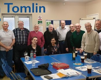 Don in a collective group photograph with two members from Tower Hamlets Health and all The Geezers members at the Tredegar Community Centre