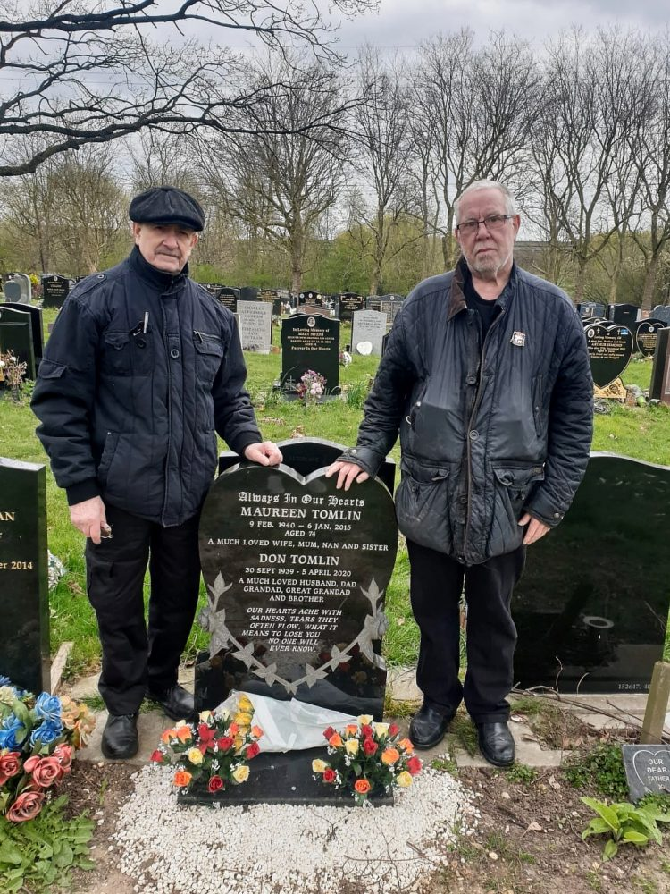 Geezers Ricky Ayliffe and Barrie Stradling at The City of London Cemetery & Crematorium, visiting the grave of their close friend and Geezers member Don Tomlin.