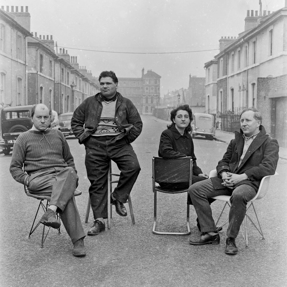 """L-R Friends Peter Smithson, Eduardo Paulozzi, Alice Smithson and Nigel Henderson. Taken for the catalogue of """"This is Tomorrow"""" exhibition at Whitechapel Art Gallery 1956. Photo courtesy of Tate Gallery."""