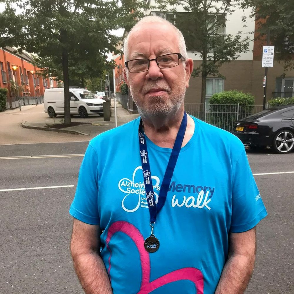 Barrie Stradling with his Alzheimer's Memory walk T-Shirt and medallion